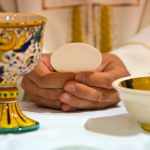 bread becomes the body of Christ in the hands of the pope, holy father